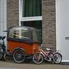 Грузовой велосипед для перевозки маленьких членов семейства