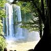 Бурные воды водопада Мисольха после дождей