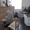 Рабочее место и незаконченная картина Сальвадора Дали.