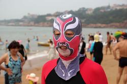 На пляжах Китая новый тренд – фейскини