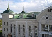 1200px-Agryz_town,_Republic_of_Tatarstan,_Russia._Train_station_hall._Frontispiece_detail,_left_wing.jpg