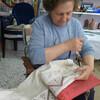 Бабушка вышивает