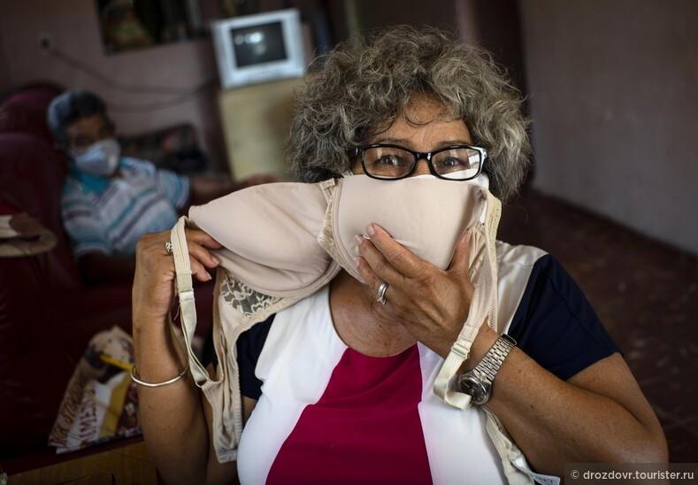 Улыбаться даже через маску. Как Куба пережила пик коронавирусной эпидемии (фото)