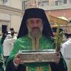 Отец Поликарп на литании Св Спиридона с десницей Святого