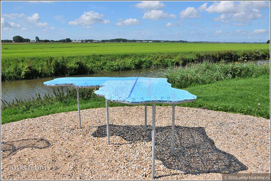 Голландский дизайн - стол прямо на природе в виде карты Голландии...