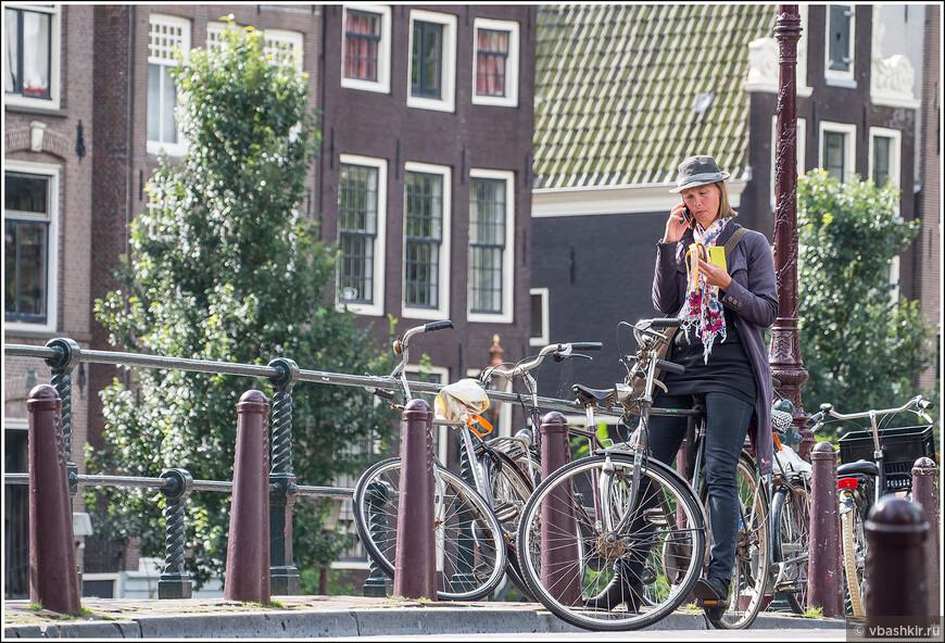 Велосипедистка на Herengracht