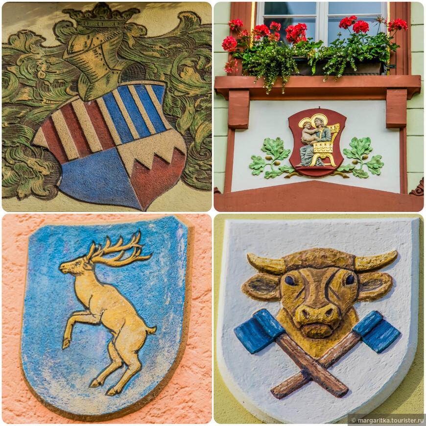 многие дома имеют свои живописные символы, эмблемы, которые не раедко дают названия своим обладателям Дом оленя, Дом быка и тд и тп.