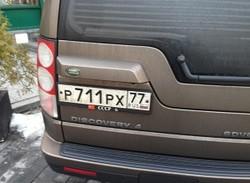 Российскому туристу грозит запрет на въезд в Литву за советский флаг