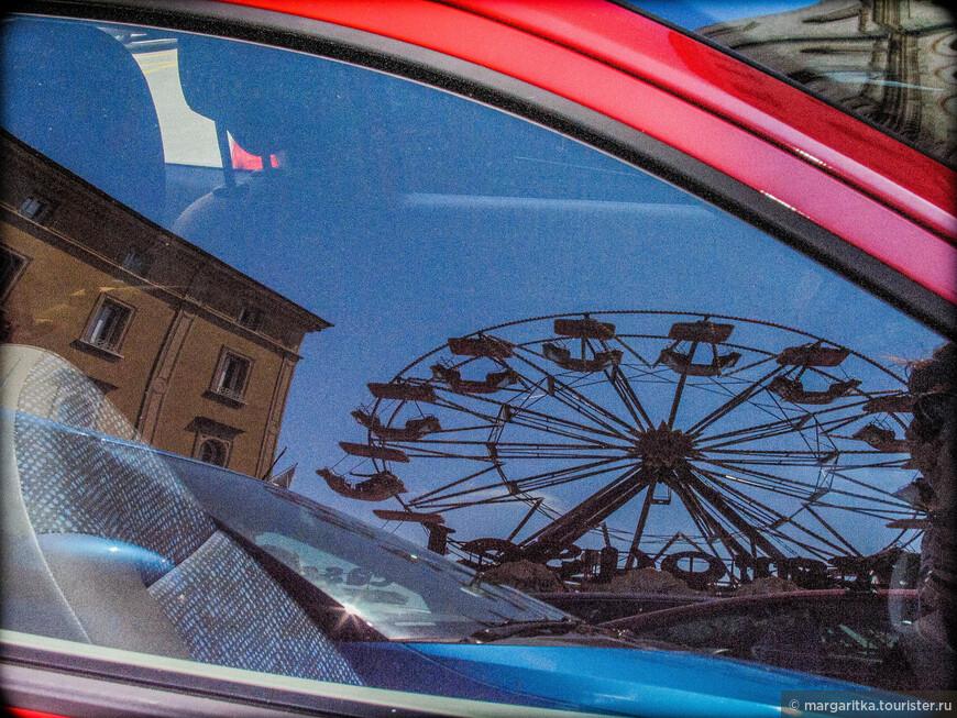 колесо обозрения в Садах Кардуччи - отражение в окне автомобиля