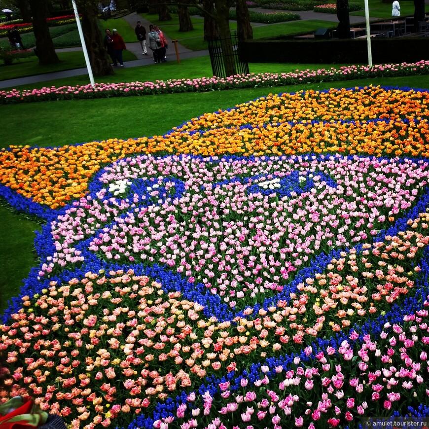 портрет Ван Гога на холмике из цветов