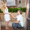 Он делает это стоя на коленях перед ней, кольцо надевает ей на палец, а не просто отдаёт его.  В такой обстановке хочется сказать только «Да»!