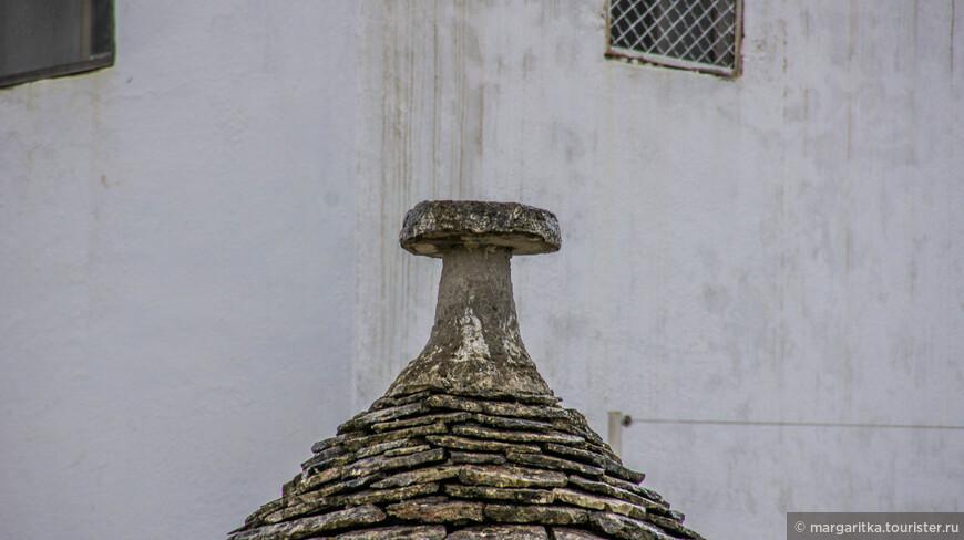 окончание крыши в виде женского символа