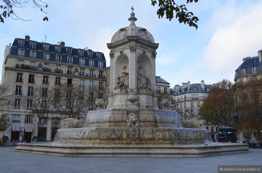Изящный фонтан на площади Сен-Сюльпис.