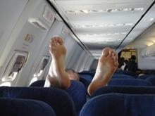 Пьяный дебош в самолете может обойтись в миллион рублей